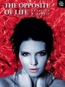 A blue skinned woman with her hands about her shoulders faces front on with a serious express, the background is red roses