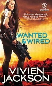 A woman with long dark hair side holding a large gun on to the left of the cover, background is fiery orange sunset