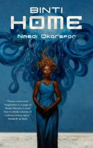 A blue background, Binti a dark skinned woman stands centrally wearing blue with swirls/tentacles in dark blue in the background.
