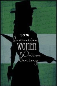 Australian Women Writers Challenge badge for 2019, forest green background with black silhouette of a woman in a hat in a frock with an umbrella. White text overlaying with the title of the challenge.